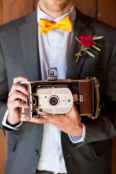 groom with vintage camera / Larissa Cleveland Photography