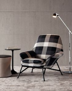 'Prince' armchair designed by Italian architect & designer Rodolfo Dordoni (b.1954) for Minotti. Love the overscaled plaid. via Minotti