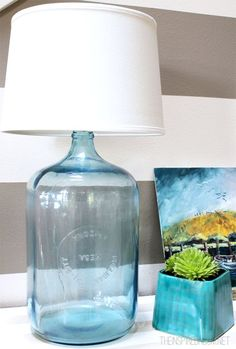 How to Make a Lamp {DIY Bottle Lamp How to make a lamp! This post explains how to make a lamp with an old glass water jug but you can make a lamp out of anything! Come see the DIY! - How to make a lamp! An easy DIY tutorial! Glass Water Jug, Old Glass Bottles, Plastic Bottles, Bottle Candles, Recycled Bottles, Sea Glass, Water Bottles, Garrafa Diy, Diy Luz