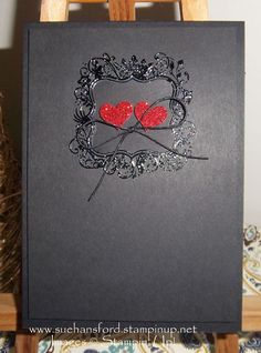 Stampin' Up! Elementary Elegance black embossed on black with itty bitty hearts punched out of red glimmer with a waxed linen bow Valentine Card