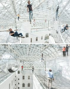 Transparent net playground.   Artist Tomás Saraceno created the 2500-square-meter installation at the Kunstammlung Nordrhein-Westfalen museum in Dusseldorf, Germany, inviting visitors to walk out onto the cloud-like nets amidst mirrored spheres.