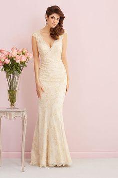 This v-neck lace sheath wedding dress is every vintage bride's dream! @allurebridals