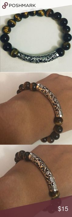 Unisex Stretch Tiger Beads Bracelet Silver Design  Unisex Stretch Tiger Beads Bracelet Silver Design this is a great bracelet to wear alone or layer. Evolving Always Jewelry Bracelets
