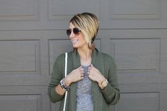 Ombre pixie hair cut with leather earrings, wood watch, and beaded bracelets