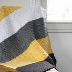 Simple instructions on making this modern crochet blanket. Good for beginners. Includes color names!: