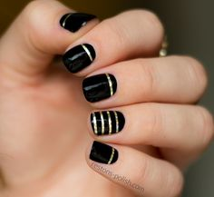 Nails. Use white paint and move gold take up to French mani line
