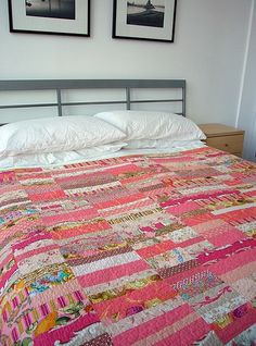I'm loving these stripey patchwork quilts!.