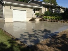 Brushed Concrete Driveway in Thamesford Ontario Driveway Ideas, Concrete Driveways, Ontario, Garage Doors, Patio, Outdoor Decor, Home Decor, Garage Ideas, Decoration Home