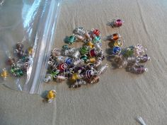 Wire wrapped multi colored beads by MarquisCreations on Etsy, $3.25