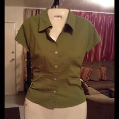 "Stretch Shirt New York & Company City Stretch Shirt is 60% Cotton and 35% Polyester and 5% Spandex. Size XS. Color green. Laying flat Arm to Arm is ""18.5. Length of shirt is ""23. This item has some wear underneath the arm Pitts but is in Good condition, Authentic and from a Smoke And Pet free home. All Offers through the offer button ONLY. I Will not negotiate Price in the comment section. Thank You New York & Company Tops"