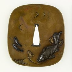 Tsuba with a Large Carp and Two Small Fish. This tsuba shows a carp swimming along with two other fish. Carp are often associated with good fortune. The back of the tsuba shows additional aquatic life in the form of a spiny lobster and a water bug. Bubbles in the water are indicated in gold. Miyata Nobukiyo (Japanese, 1817-1884)