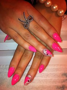 Pink stiletto nails.