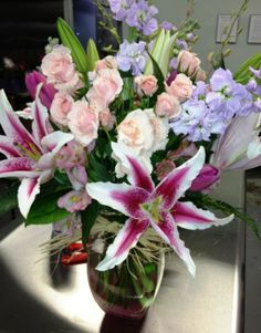 Stargazer Lilies, spray roses and stock create this lovely custom mix.