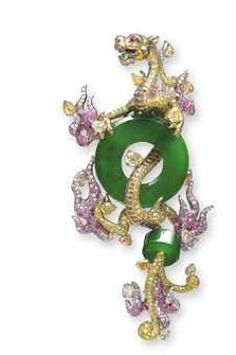 A Jadeite Dragon Brooch by WALLACE CHAN