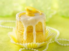 Champagne cupcake with lemon filling and glaze!