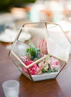 Spring flower arrangement in terrarium, artificial