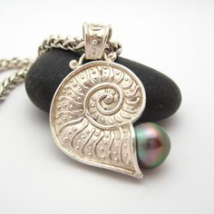 Silver nautilus with pearl.
