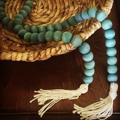 Wood bead garland. Teal, turquoise, blue. Farmhouse style DIY Wood Bead Garland, Beaded Garland, Decorative Beads, Pom Pom Garland, Baubles And Beads, Homemade Christmas Gifts, Craft Sale, Diy On A Budget, Diy Craft Projects