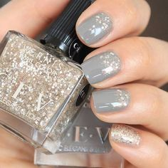 The 35 Prettiest Wedding Nail Colors - soft gray nails with gold glitter accents