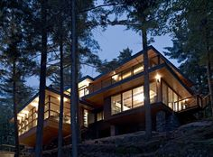 Forest House: Lake Joseph Cottage by Altius Architecture, Seguin Township, Ontario