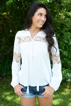 You'll be the envy of everyone in this classic lace peasant style top by Wishlist! This lightweight beauty will look absolutely perfect paired with shorts now and jeans later! Gorgeous lace cuts out c