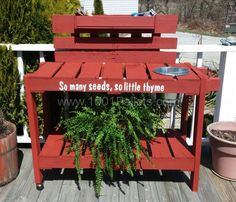 Pallet potting table with 2 casters to easily move, a towel rack and a galvanized pale.