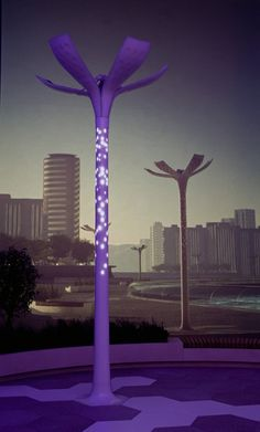 LED street pole that looks like a flower that charges on solar and wind power