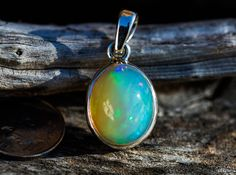 Hey, I found this really awesome Etsy listing at https://www.etsy.com/listing/257284723/ethiopian-opal-pendant-green-blue-pink