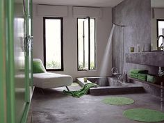 Oh, j'aime, j'aime beaucoup this bathroom. More like a bath suite than a bathroom… look at this Italian shower/bath built in-ground with hydraulic concrete, the tilt swing windows and this very inviting lounge chaise covered with towel-like water absorbing fabric, just perfect to lay down and stay zen after a relaxing shower… and these subtle...