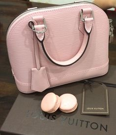 Pink LV Alma BB with rose macarons.