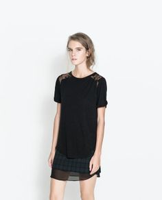 Image 1 of T-SHIRT WITH STARS ON THE SHOULDERS from Zara