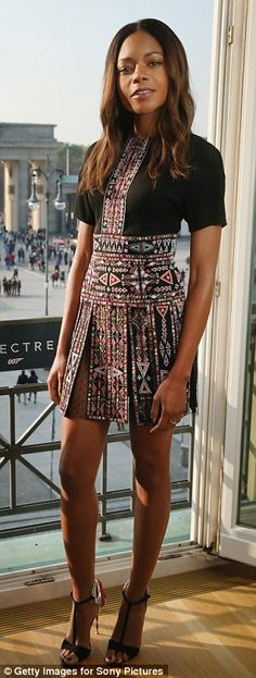 Naomi wore an Aztec-inspired mini at a photocall at the Hotel Aldon overlooking theBrande...