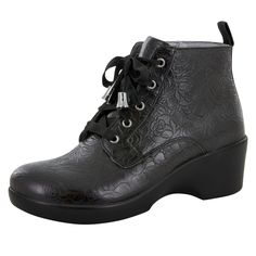 Ankle boot featuring soft velvet laces and a Black Bloom genuine printed suede. Features a zipper on the side to easily slip the boots on and off. Leather cover