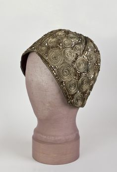 Deco sequined evening cap, c.1925. By the late 1920s, the bell-shaped cloche had been pared down to the skull cap, obeying the dictates of the new streamlined modernism.