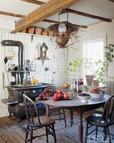 woodstove, exposed beams, and antique dining set