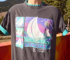 Tag: MSP - made in USA  Era: late 80s to early 90s  Fabric: cotton Size reads: XL, fits on the modern Large side, please check measurements  Measures: 23 inches across the chest, 28.5 inches neck seam to hem down center back  Colors: faded black t-shirt with contrast teal optional roll up