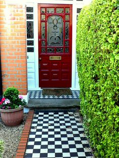 Red Door, mosaic blk/wht walkway. This has got to be an English home.