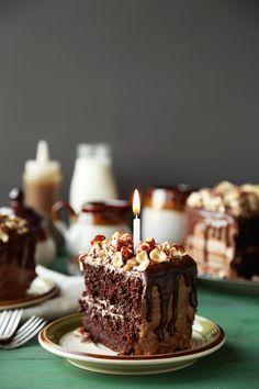 Chocolate Butterscotch Hazelnut Cake. A decadent chocolate cake made with homemade butterscotch, nutella frosting and topped with chopped hazelnuts!