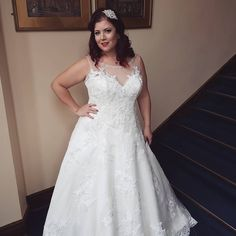 This illusion neckline plus size wedding gown is sleeveless.  There light lightly beaded lace detail throughout. We are in the USA and can easily make custom plus size wedding dresses like this for you with any changes you want or need. Our dress design firm can also provide #replicas to brides that can not afford the original designer dress.  Get pricing on plus size wedding dresses when you visit www.dariuscordell.com