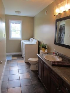 Ensuite bath with shower!  Love that I can throw my clothes in the washer and dryer here and then right back into my bedroom.  After all most of the washings come from your own closet!