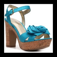 Turquoise heels Adorable shoe.  Worn only twice.  Still have original box Kelly & Katie Shoes