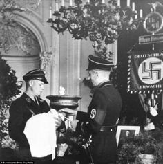 These two SS men are at the christening of a baby in 1936, three years before the start of the Second World War. The SS were Hitler's personal bodyguard and were under the command of Heinrich Himmler. The SS replaced the SA as the party's police