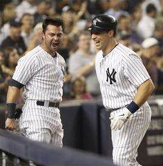 GAME 116: Tuesday, Aug. 14, 2012 - New York Yankees' Mark Teixeira, right, is greeted by Nick Swisher after Teixeira hit a solo home run during the seventh inning of the baseball game against the Texas Rangers at Yankee Stadium in New York. Swisher and Teixeira hit back-to-back home runs in the inning.