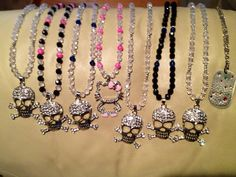 Serious Skulls- Can be made in and length or color -$45.00  - Hello Kitty Bling $ 40.00 -Love Tags $ 35.00  order here www.etsy.com/shop/Rackbling