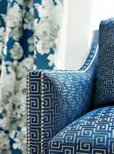 Classic meander chair upholstery fabric in blue. Meander is an ancient decoration pattern that dates to ca. 900 - 700 BC and focuses on geometrical symmetry.
