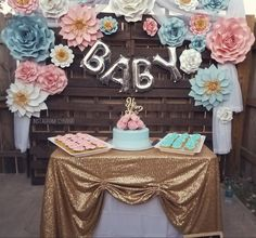 Gender reveal cake, gender reveal cake topper, wooden pallet background, DIY, paper flowers, baby balloon sign, sequins tablecloth,