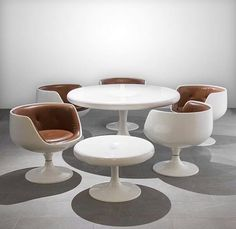 Some pop mod with these 'Cognac' chairs and 'Chanterelle' tables designed by Eero Aarnio. Made from gel-coated fiberglass and upholstered in leather they were produced by Asko of Finland in the 1960s