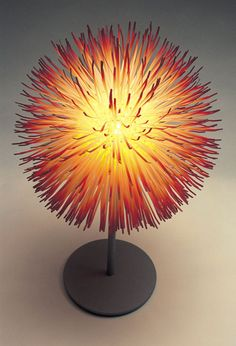 Eight-Fifty Lamp by Claire Norcross - a light made from nylon cable ties, dyed to the required colour