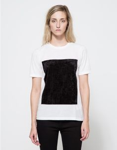 From Cheap Monday, a classic lightweight white tee with large soft velvet front patch. Features rounded neckline, short sleeves, large rectangular soft velvet front patch, straight hem, slightly sheer finish and classic fit.  •Lightweight white tee wit
