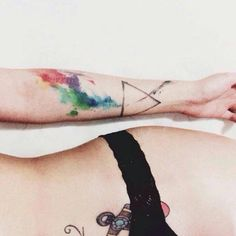 Watercolor style tattoo inspired by Pink Floyd's The Dark Side of the Moon album cover. Tattoo Artist: Victor Octaviano